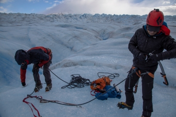 preparing for abseiling into crevasse