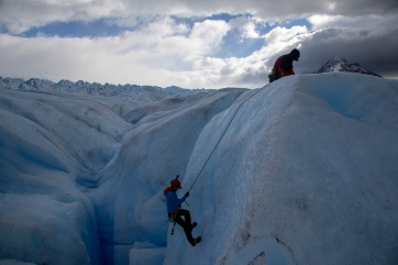 Abseiling into crevasse